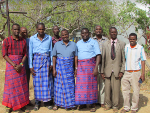 korr pastors in traditional long blue outfits